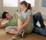 Couple relaxing on an empty floor
